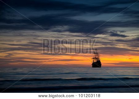 Pirate ship in sunset scenery.