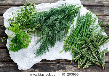 Fresh Green Vegetables Herbs. Dill, Rosemary, Parsley, Chives And Thyme. On Old Wooden Table.