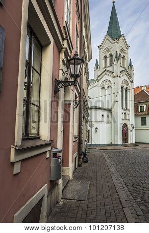 Morning street in medieval town of old Riga city Latvia. Walking through medieval streets of old Riga tourists can find unique architectural ensembles and ancient houses poster