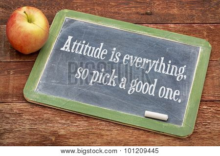 Attitude is everything, so pick a good one - positive motivational words on a slate blackboard against red barn wood