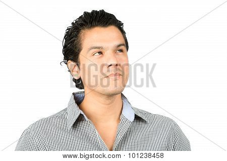 Portrait of a thinking reserved hispanic man in casual clothes looking up to the side at blank copy space or product placement with pensive facial expression showing curiosity interest wonder poster