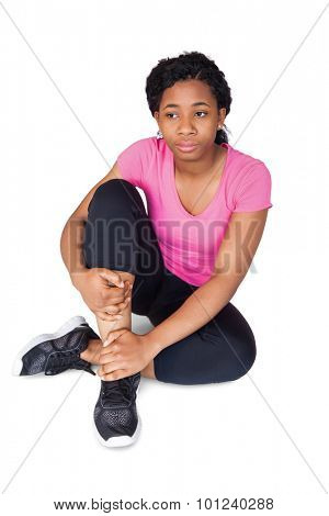 Fit woman with ankle injury on white background poster