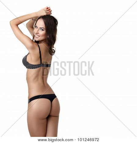 Sexy tanned model in trendy polka dot underwear, isolated on white poster