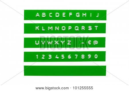 Embossed alphabet on green plastic tape