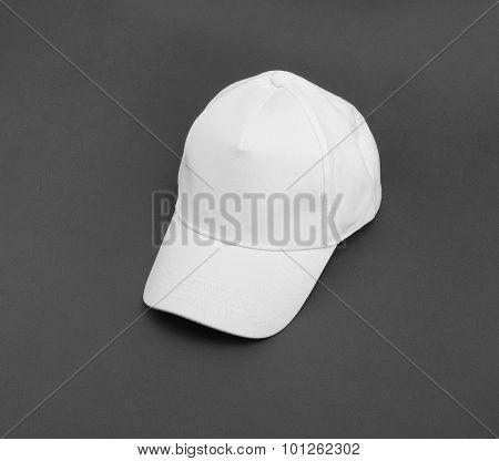 White Baseball Cap On Gray Background.