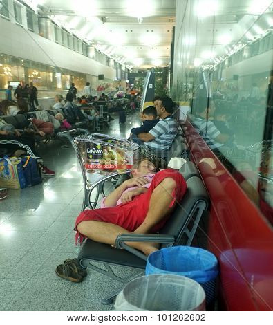 Tired passengers sleep at the airport