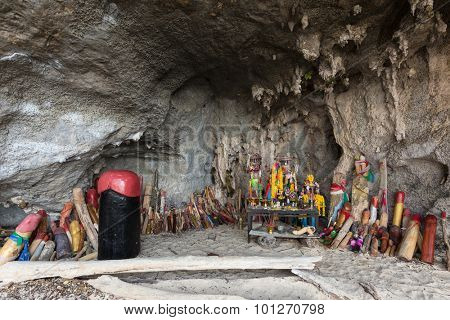 Religious phallus symbols offerings in the cave of the Princess Pranang, Krabi, Thailand