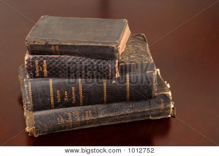 Stack Of Old Bibles Including German Bibles