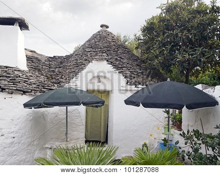 White Trulli Of Alberobello With Roofs Cone-shaped