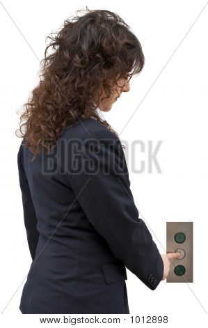 Woman Pushing The Button Of Elevator