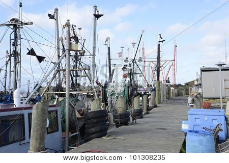 Commercial Fishing Boats By A Wood Dock