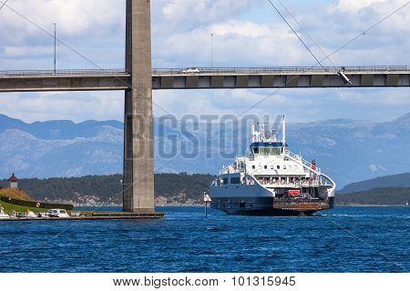 Car passenger ferry under bridge leaving port in Stavanger Norway. poster