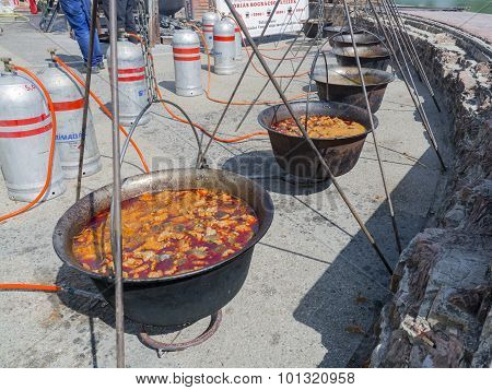 Row Of Kettles Of Fish Soup