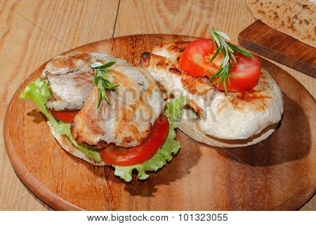 Toast bread with grilled turkey escalope tomato slices and lettuce garnished with rosemary poster