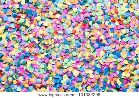a macro shot of colorful round confetti poster