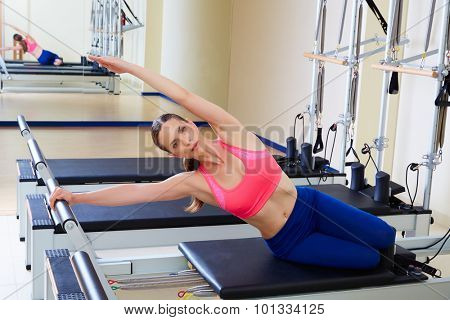 Pilates reformer woman mermaid exercise workout at gym indoor poster
