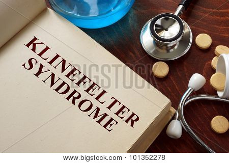 Klinefelter syndrome written on book with tablets.