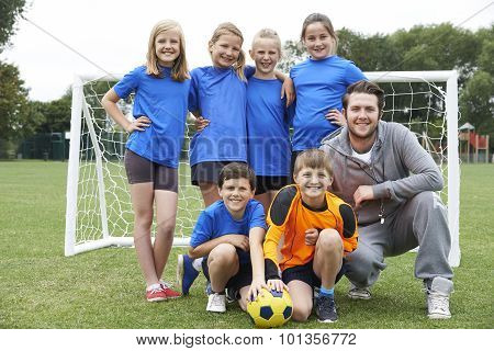 Portrait Of School Soccer Team With Coach
