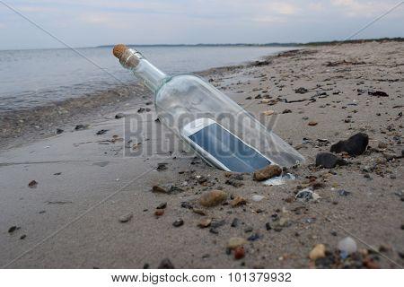 Digital Native Castaway Sending A Help Message In A Bottle