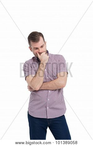 Young Man In Casual Shirt Holds His Chin And Thinks About The Best Solution Of The Problem.isolated