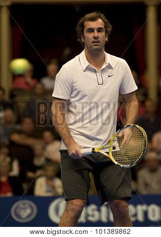 LONDON, ENGLAND. 05 DECEMBER 2009 -   Cedric Pioline (FRA) watches the ball fly past him while competing in the season finale to the ATP Champions Tour match during the AEGON Masters Tennis