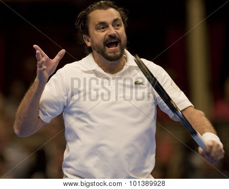 LONDON, ENGLAND. 05 DECEMBER 2009 -   Henri Leconte (FRA) competing in the season finale to the ATP Champions Tour match during the AEGON Masters Tennis, Royal Albert Hall, London.