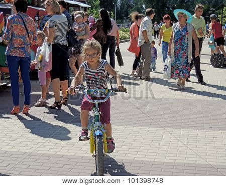 Cycling On The Park Alley