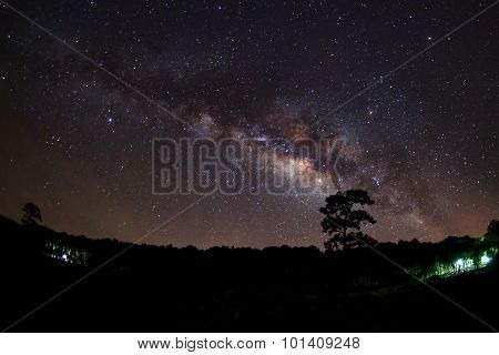 Silhouette of Tree with cloud and Milky Way at Phu Hin Rong Kla National Park,Phitsanulok Thailand. Long exposure photograph. poster