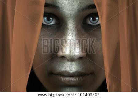 Face of shy freckled woman with veil and beautiful big eyes