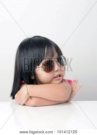 Little girl portrait wearing sun glasses