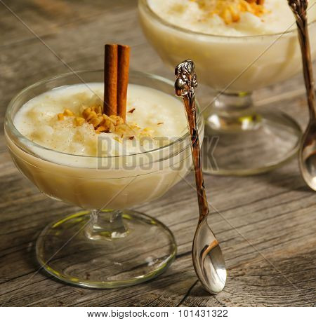 Rice pudding with cinnamon sweet dessert side view