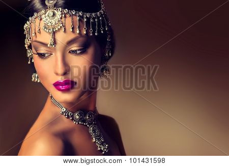elegant Indian girl looking to the side with  traditional Indian jewelry