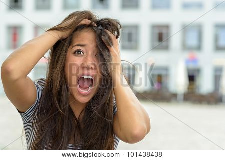 Woman Yelling And Tearing At Her Hair