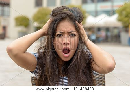 Young Woman With A Frantic Expression