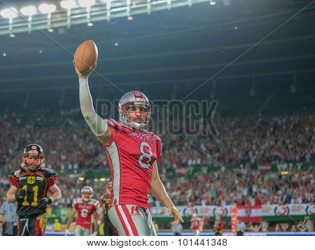 VIENNA, AUSTRIA - JUNE 7, 2014: QB Christoph Gross (#8 Austria) celebrates a touchdown.