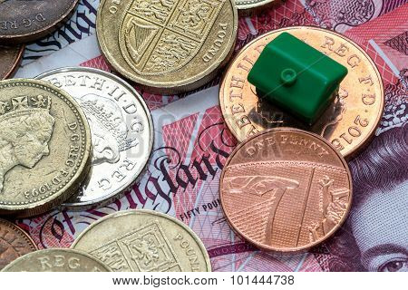 Green Plastic Model House And English Coins And Notes
