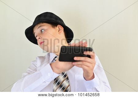 Boy teenager turns away from a cell phone poster