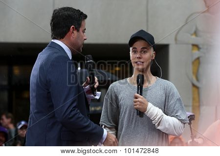 NEW YORK-SEP 10: Singer Justin Bieber (R) and Carson Daly on NBC's 'TODAY Show' at Rockefeller Plaza on September 10, 2015 in New York City.