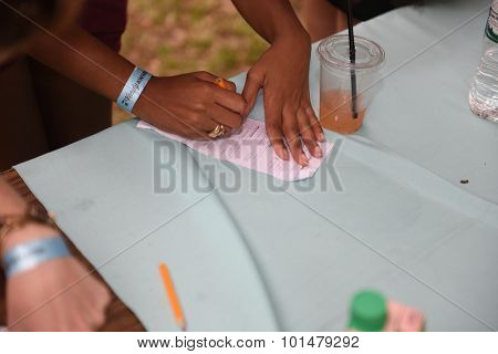 Filling out ballots for People's Choice