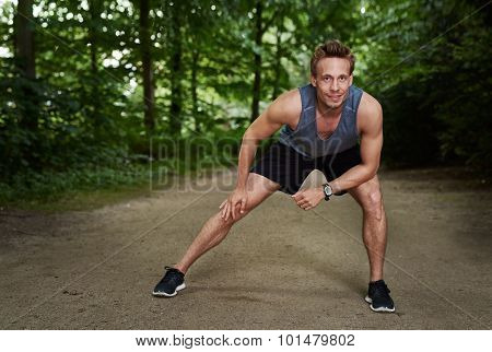Athletic Man Doing Warm Up Exercise At The Park