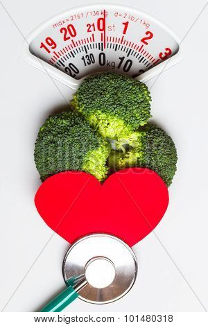 Broccoli With Stethoscope On Weight Scale. Dieting