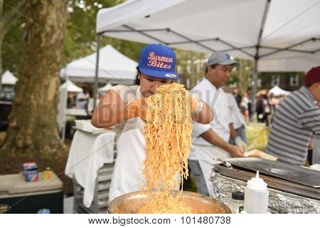 Mixing pasta at Burmese Bites