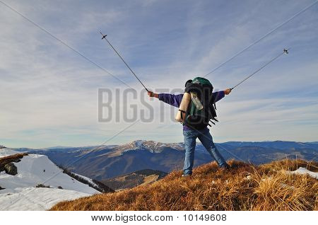 The tourist submits signals on an autumn hillside