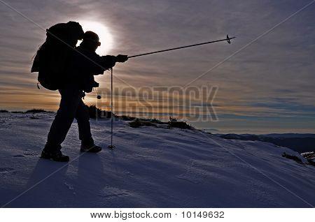 The tourist on an evening hillside