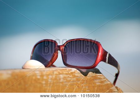 Sunglasses by the ocean