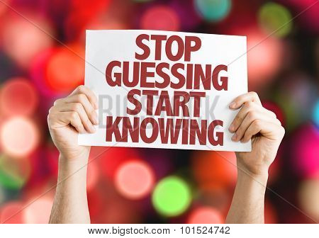 Stop Guessing Start Knowing placard with bokeh background