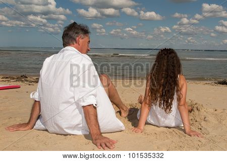 Grand Father And Her Grand Child On The Beach
