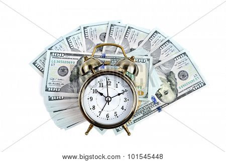 Alarm clock on money background