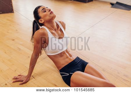 Tired Woman Resting After Workout