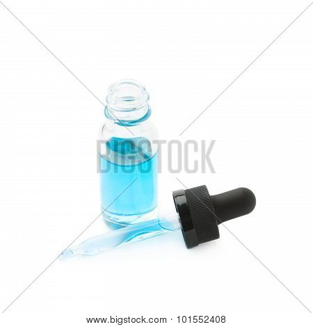 Small bottle with a pipette isolated